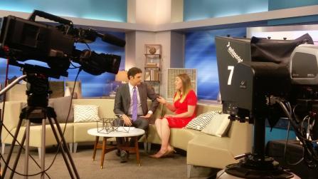 entrepreneur client doing tv interview